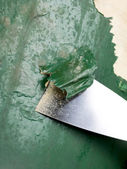Scraping paint on the wall — Stock Photo
