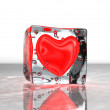 Red heart frozen in ice — Stock Photo #11849572