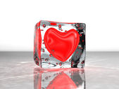 Red heart frozen in ice — Stock Photo