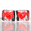 Two red hearts frozen in ice — Stock Photo #11850415