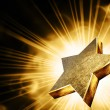 Gold star in the rays - Stock Photo