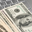 Stock Photo: Dollars on a laptop