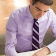 Attractive guy writing — Stock Photo