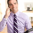 Cute guy on phone with leather pad — Stock Photo #11745458