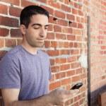 ������, ������: Cute guy by brick wall