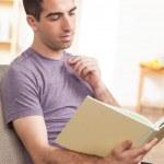 Cute guy reading book — Stock Photo