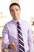 Good looking business man shaking hand — Stock Photo