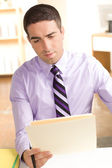 Man looking at folder — Stock Photo