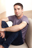 Cute guy in chair — Stock Photo