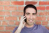 Handsome man on phone — Stock Photo