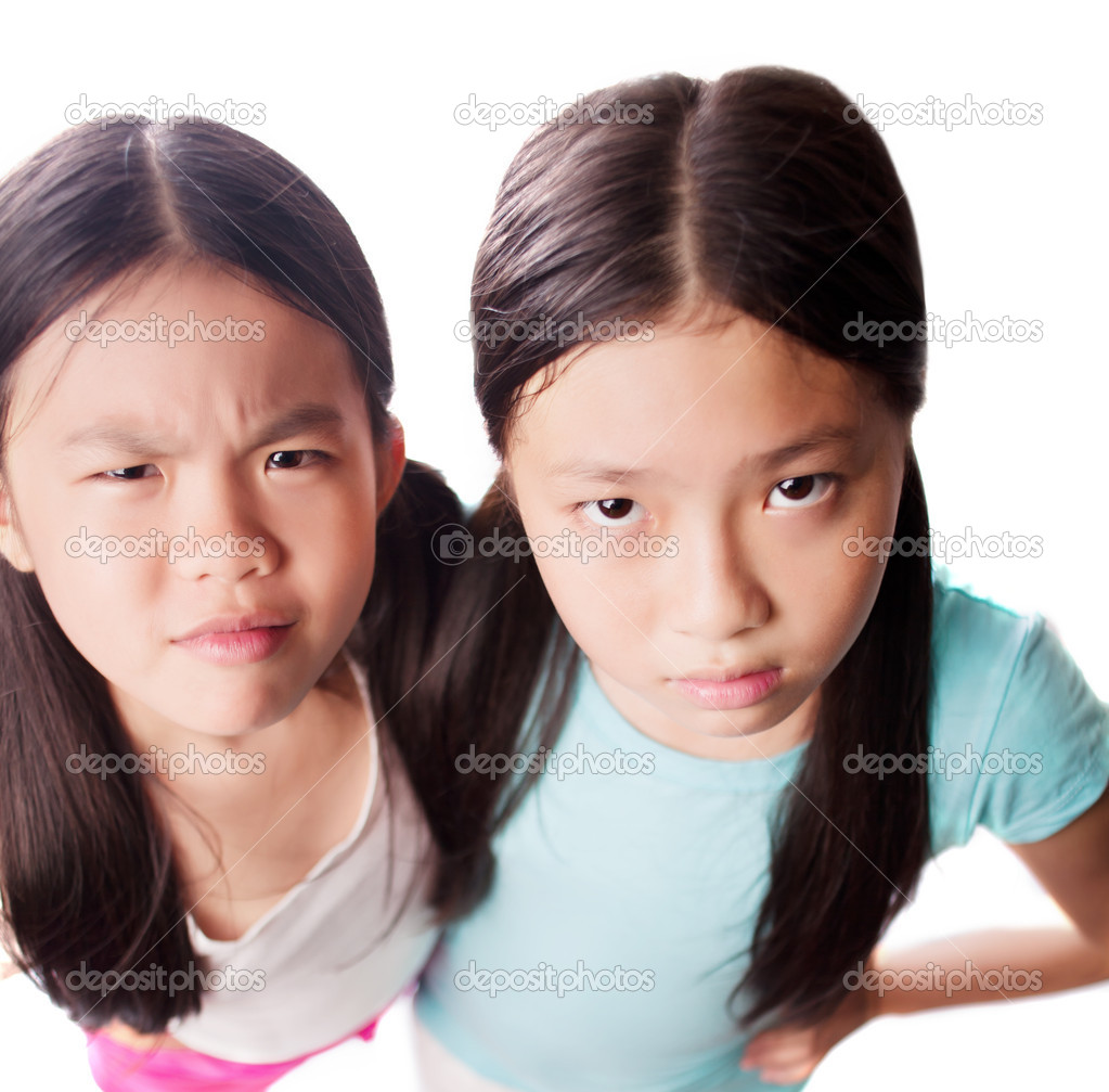 Portrait of little girls staring at you with discontent — Stock Photo #12181374