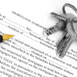 Mortgage agreement with pen and keys — Stock Photo #11236189