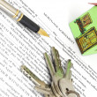 Mortgage agreement with pen and keys — Stock Photo #11236200