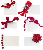 White tags with red ribbons collection — Stock Photo