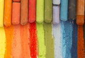 Colorful crayons creating rainbow — Stock Photo