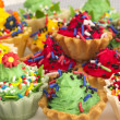 Royalty-Free Stock Photo: Colorful cup cakes with confetti