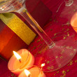 Celebration with burning candles and glasses — Stock Photo #11248386