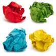 Collection of colorful crumpled papers over white background — Stock Photo
