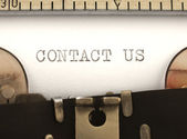 Contact Us title on the typewriter — Stock Photo