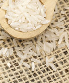 Rice in the wooden spoon — Stock Photo