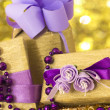 Royalty-Free Stock Photo: Golden gift boxes with beautiful purple decoration