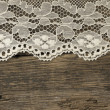 Beautiful old fashion lace on the wooden background — Stock Photo