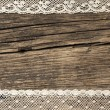 Stock Photo: Beautiful old fashion lace on wooden background