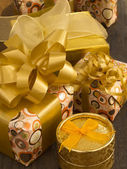Gift bixes witg bows on the wooden table — Stock Photo