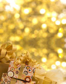 Plenty of gifts over shiny background — Stock Photo