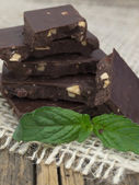 Chocolate with mint leaves — Stock Photo
