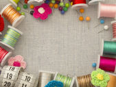 Border made of bobbins and other sewing materials — Stock Photo