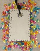 Etiqueta con puntadas a mano sobre brillante decoración floral — Foto de Stock