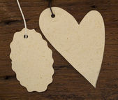 Heart tag on the wooden background — Stock Photo