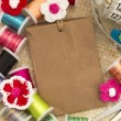 Paper tag with sewing material — Stok fotoğraf