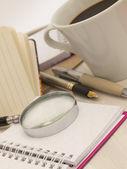 笔记本与杯咖啡 — 图库照片