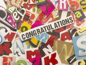 Ordet gratulationen med skära bokstäver — Stockfoto