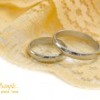 Golden wedding rings on the yellow textile background  — Stock Photo #11282123
