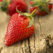 Strawberries on the wooden background — ストック写真