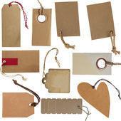Collection of cardboard corrugated paper tags or labels — Stock Photo