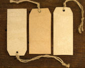 Blank tags on the wooden background — Stock Photo
