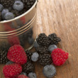 Stock Photo: Raspberries and blueberries