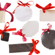 Black and white tags with red ribbons — Stock Photo