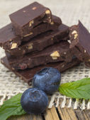 Chocolate bars with blueberries — Stock Photo