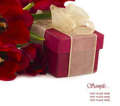 Red gift box with tulips — Stock Photo