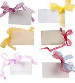 Tags with beautiful colored ribbons — Stock Photo
