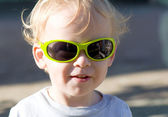 Little boy wearing sunglasses — Foto de Stock