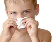 Sick boy blowing his nose — Stock Photo