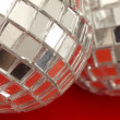 Decorative disco balls on the red background — Stock Photo #11330226