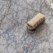 Little bus on the map - Stock Photo