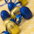 Blue and golden Easter eggs — Stock Photo